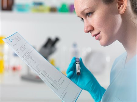 results - Technician holding blood sample in clinical laboratory with test results Stock Photo - Premium Royalty-Free, Code: 649-07279773