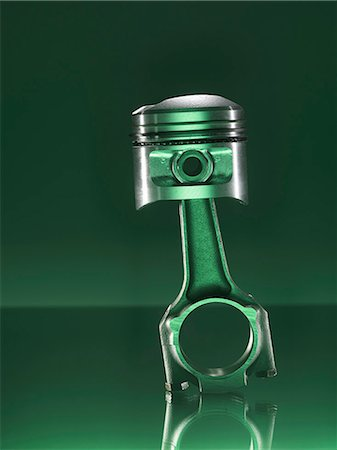 Car piston on green background Stock Photo - Premium Royalty-Free, Code: 649-07279864