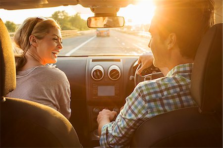 Young couple driving in car Stock Photo - Premium Royalty-Free, Code: 649-07279933