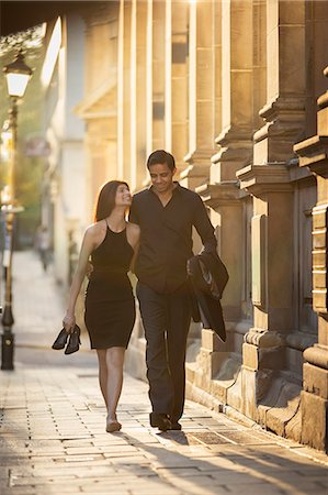 Couple walking on pavement, Birmingham, England, UK Stock Photo - Premium Royalty-Free, Code: 649-07279945