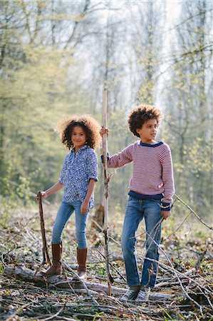 sister - Brother and sister playing together in woods Stock Photo - Premium Royalty-Free, Code: 649-07280018