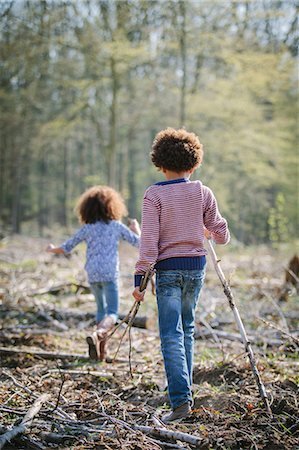 Brother and sister walking together in woods Stock Photo - Premium Royalty-Free, Code: 649-07280019