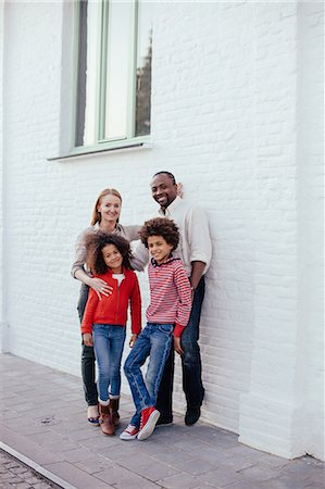 Portrait of parents and two children on sidewalk Stock Photo - Premium Royalty-Free, Code: 649-07280037