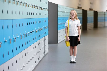 school girl uniforms - Portrait of schoolgirl in corridor Stock Photo - Premium Royalty-Free, Code: 649-07280044