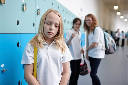 school girl uniforms - Schoolgirl being bullied in school corridor Stock Photo - Premium Royalty-Free, Code: 649-07280055