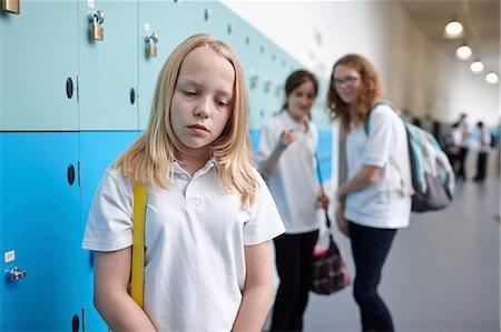 Schoolgirl being bullied in school corridor Stock Photo - Premium Royalty-Free, Code: 649-07280055