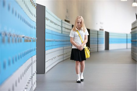 school girl uniforms - Unhappy schoolgirl walking alone in school corridor Stock Photo - Premium Royalty-Free, Code: 649-07280057