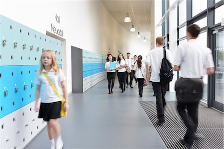 school girl uniforms - Unhappy schoolgirl walking in school corridor Stock Photo - Premium Royalty-Free, Code: 649-07280058