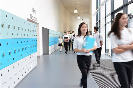school girl uniforms - Schoolchildren walking through school corridor Stock Photo - Premium Royalty-Free, Code: 649-07280059