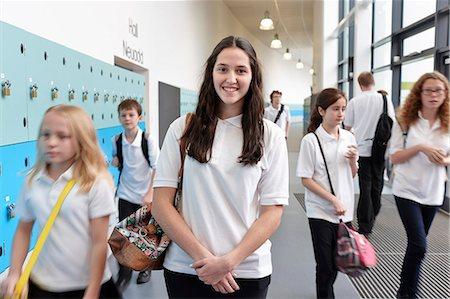 school girl uniforms - Schoolchildren in school corridor Stock Photo - Premium Royalty-Free, Code: 649-07280060