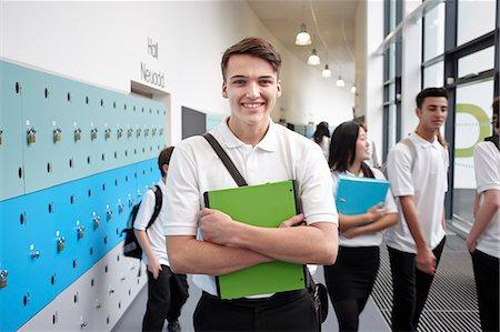 school girl uniforms - Portrait of teenage boy holding file in school corridor Stock Photo - Premium Royalty-Free, Code: 649-07280061