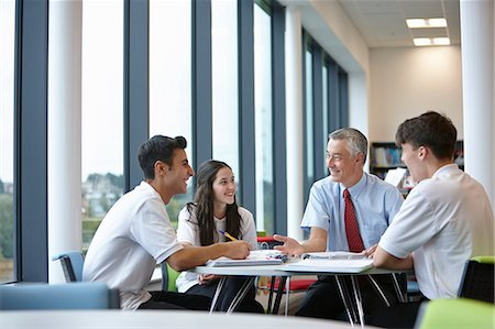 Group of teenagers working with teacher in school class Stock Photo - Premium Royalty-Free, Code: 649-07280074