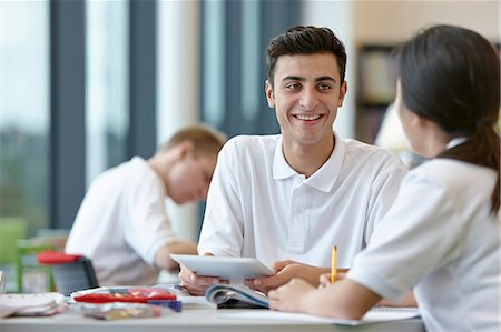 Teenagers working together in school classroom Stock Photo - Premium Royalty-Free, Code: 649-07280077