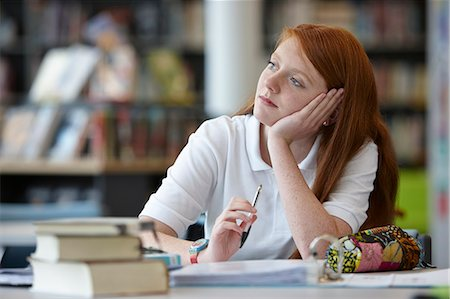 school girl uniforms - Portrait of teenage girl daydreaming in library Stock Photo - Premium Royalty-Free, Code: 649-07280071