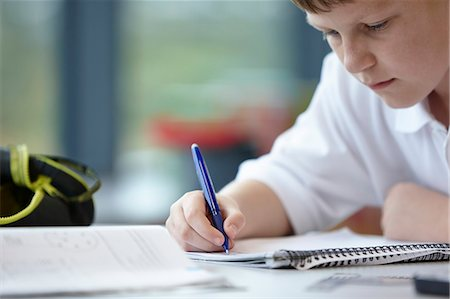 school work - Close up of schoolboy writing in class Stock Photo - Premium Royalty-Free, Code: 649-07280072