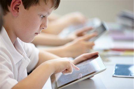 Close up of schoolchildren working in class Stock Photo - Premium Royalty-Free, Code: 649-07280085
