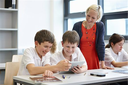 Schoolchildren working in class with teacher Stock Photo - Premium Royalty-Free, Code: 649-07280086