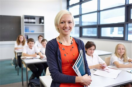 school girl uniforms - Portrait of female teacher with class Stock Photo - Premium Royalty-Free, Code: 649-07280087