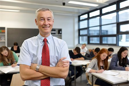 Portrait of mature male teacher in classroom Stock Photo - Premium Royalty-Free, Code: 649-07280095