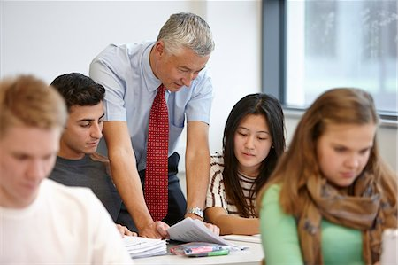 Teacher working with teenagers in classroom Stock Photo - Premium Royalty-Free, Code: 649-07280093