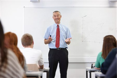 Mature male teacher in front of class Stock Photo - Premium Royalty-Free, Code: 649-07280107