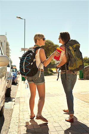 Two female backpackers with map, Cape Town, South Africa Stock Photo - Premium Royalty-Free, Code: 649-07280144