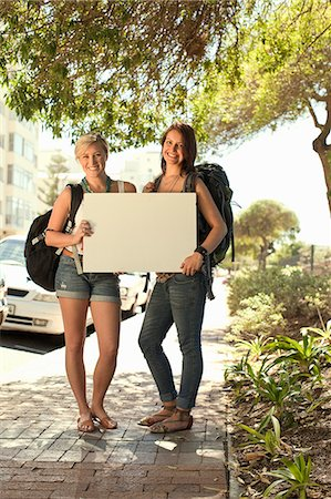 Two female backpackers with blank board, Cape Town, South Africa Stock Photo - Premium Royalty-Free, Code: 649-07280145