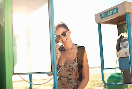 Young woman using phone booth, Cape Town, South Africa Stock Photo - Premium Royalty-Free, Code: 649-07280142