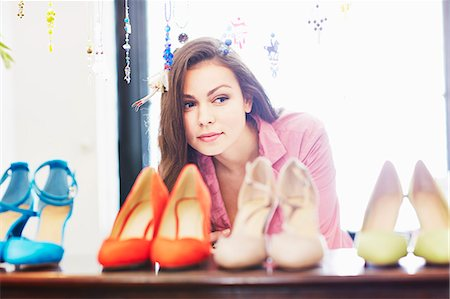 decision - Young woman looking at selection of high heeled shoes Stock Photo - Premium Royalty-Free, Code: 649-07280202