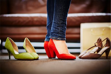 Woman trying on high heeled shoes Stock Photo - Premium Royalty-Free, Code: 649-07280210