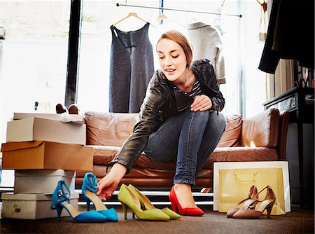 self indulgence - Woman trying on high heeled shoes Stock Photo - Premium Royalty-Free, Code: 649-07280211