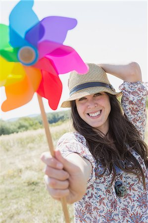 Mid adult woman holding windmill Stock Photo - Premium Royalty-Free, Code: 649-07280263