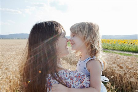 Mother and daughter in wheat field hugging Stock Photo - Premium Royalty-Free, Code: 649-07280289