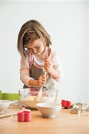 Girl mixing batter in bowl Stock Photo - Premium Royalty-Free, Code: 649-07280350