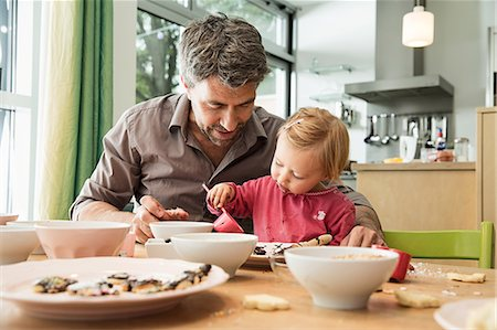 playing - Father and daughter baking in kitchen Stock Photo - Premium Royalty-Free, Code: 649-07280369
