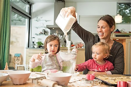 Mother and children baking in kitchen Stock Photo - Premium Royalty-Free, Code: 649-07280362