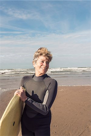 Mature female bodyboarder on Devon beach, UK Stock Photo - Premium Royalty-Free, Code: 649-07280387