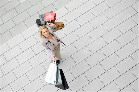Portrait of mid adult woman with abundance of shopping bags Stock Photo - Premium Royalty-Free, Code: 649-07280419