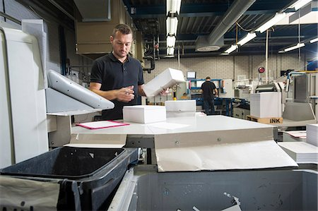 paper - Worker preparing paper for machine in print workshop Stock Photo - Premium Royalty-Free, Code: 649-07280523