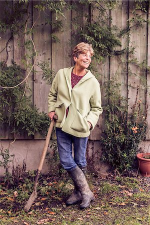 Portrait of mature woman leaning on spade in garden Stock Photo - Premium Royalty-Free, Code: 649-07280589