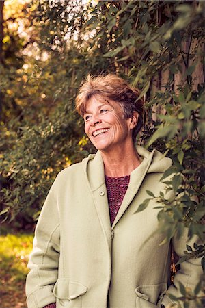 Portrait of mature woman in garden Stock Photo - Premium Royalty-Free, Code: 649-07280591