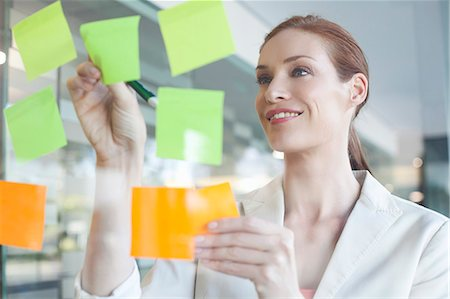 self adhesive note - Businesswoman brainstorming using sticky notes Stock Photo - Premium Royalty-Free, Code: 649-07280666