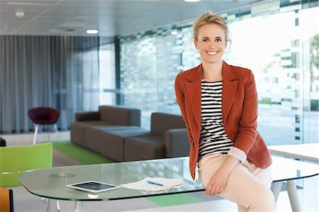 small business owners - Businesswoman sitting on desk Stock Photo - Premium Royalty-Free, Code: 649-07280669