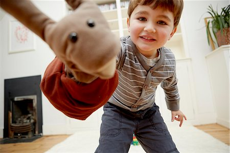Boy playing with hand puppet Stock Photo - Premium Royalty-Free, Code: 649-07280685