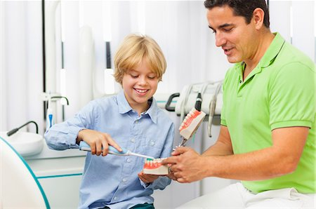 dentistry - Dentist teaching boy how to brush teeth Stock Photo - Premium Royalty-Free, Code: 649-07280853