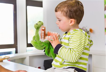 dentistry - Boy playing with toy crocodile in dentists Stock Photo - Premium Royalty-Free, Code: 649-07280867