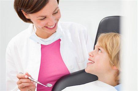 dentistry - Boy having check up, dentist holding dental mirror Stock Photo - Premium Royalty-Free, Code: 649-07280861
