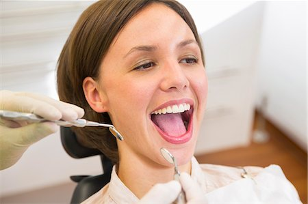dentistry - Woman having check up at dentists with mouth open Stock Photo - Premium Royalty-Free, Code: 649-07280872