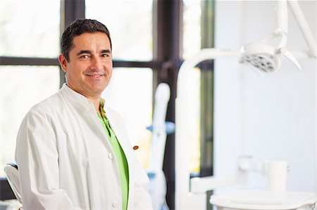 dentistry - Portrait of male dentist smiling Stock Photo - Premium Royalty-Free, Code: 649-07280885