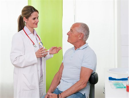 Female doctor talking to senior male patient Stock Photo - Premium Royalty-Free, Code: 649-07280893